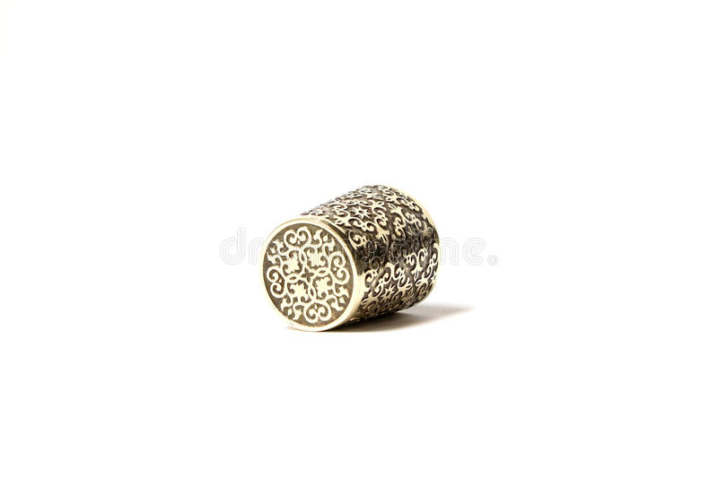 Hand made brass thimble with ornament royalty free stock photo