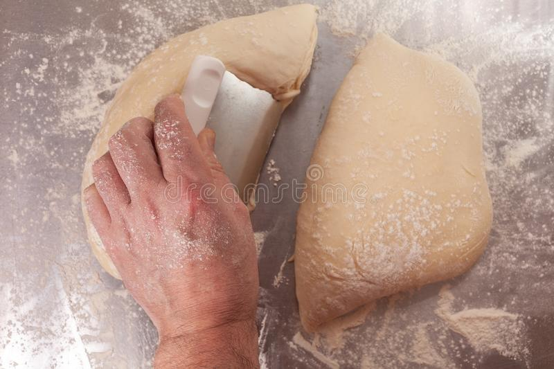 Hand made bread dough being prepared royalty free stock photography