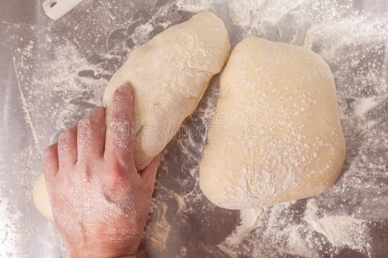 Hand made bread dough being prepared royalty free stock photo
