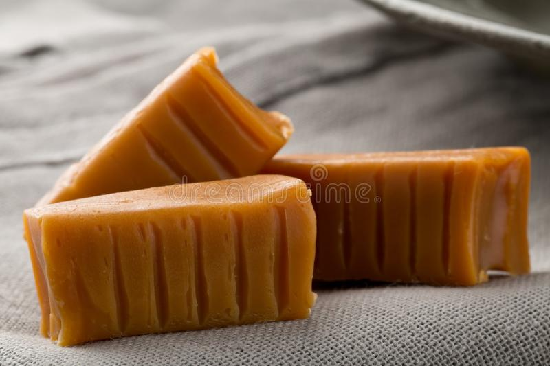 Hand made caramel toffee pieces in kitchen stock images