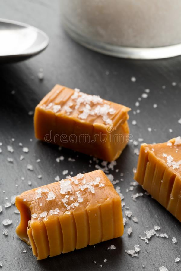 Hand made caramel toffee pieces with sea salt royalty free stock photos