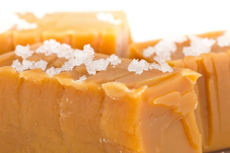 Hand made caramel toffee pieces with sea salt macro royalty free stock images