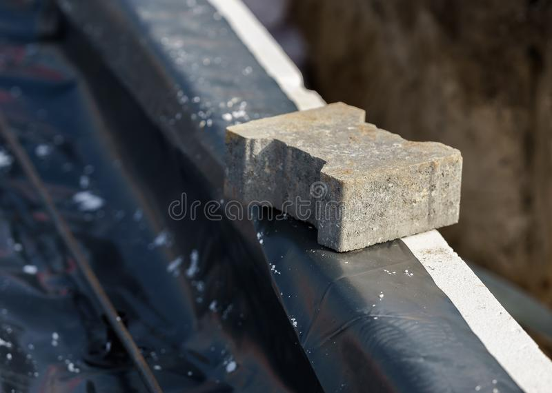 Hand-made construction of the house, insulation of the foundation slab. Hand-made construction of house, insulation of the foundation slab stock photo