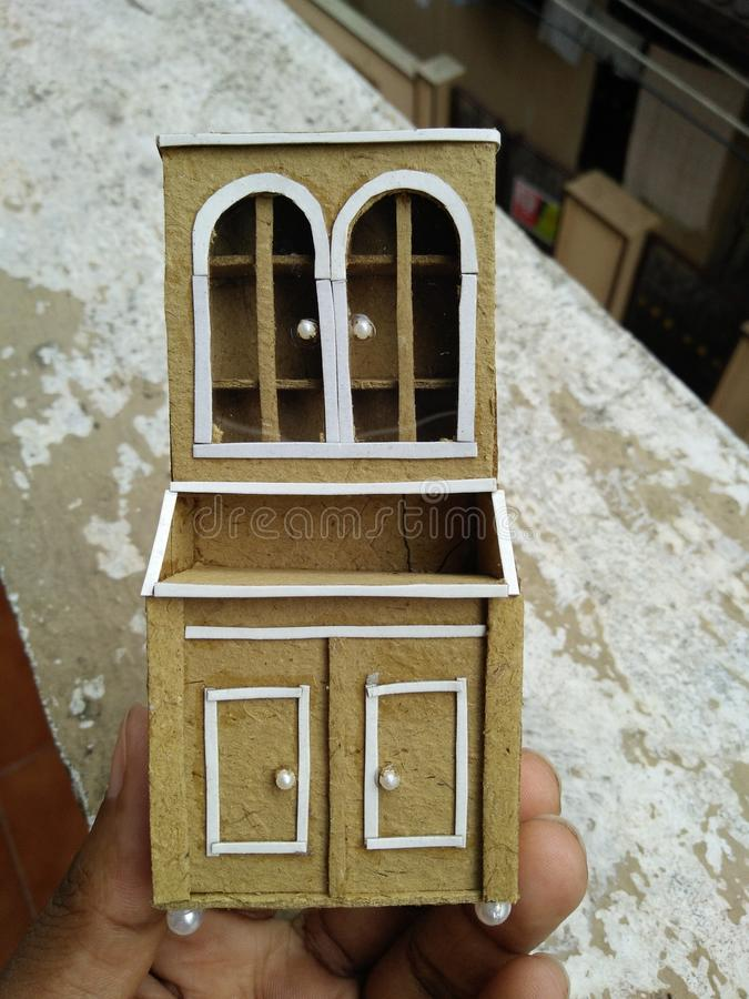 Hand made craft. Miniature craft kitchen cabinet royalty free stock photography