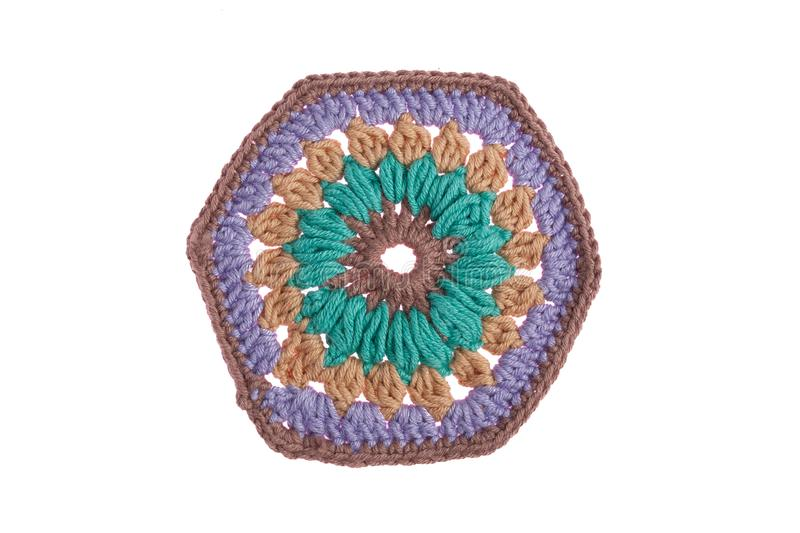 Hand-made decorative napkin, crocheted with colorful threads stock images