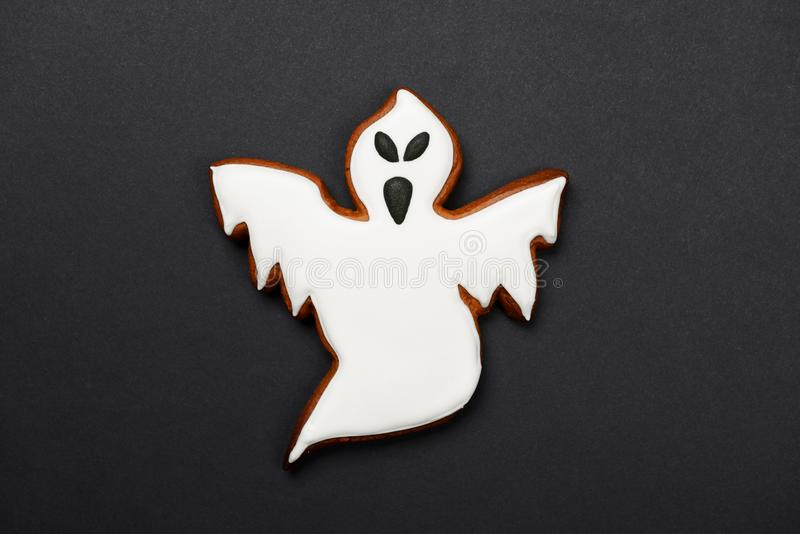 The hand-made eatable gingerbread Halloween ghost royalty free stock photography