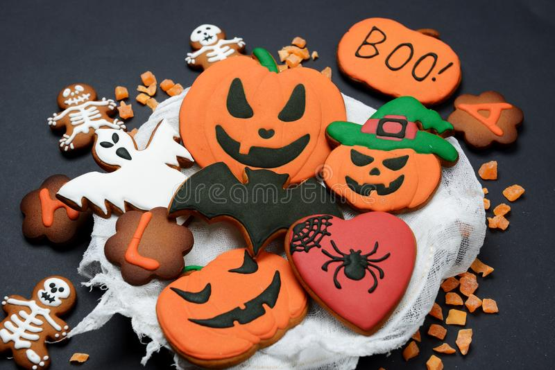 The hand-made eatable gingerbread Halloween pumpkin, ghosts, bat and skeletons royalty free stock photo