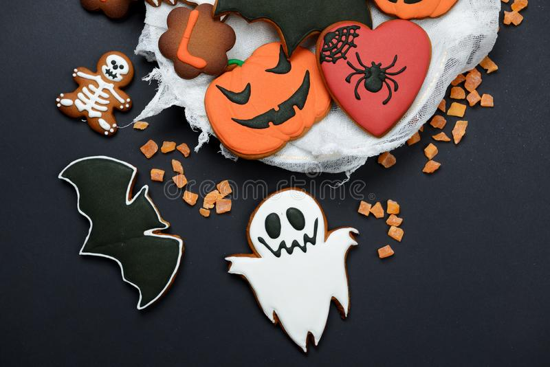 The hand-made eatable gingerbread Halloween pumpkin, ghosts, bat and skeletons stock image