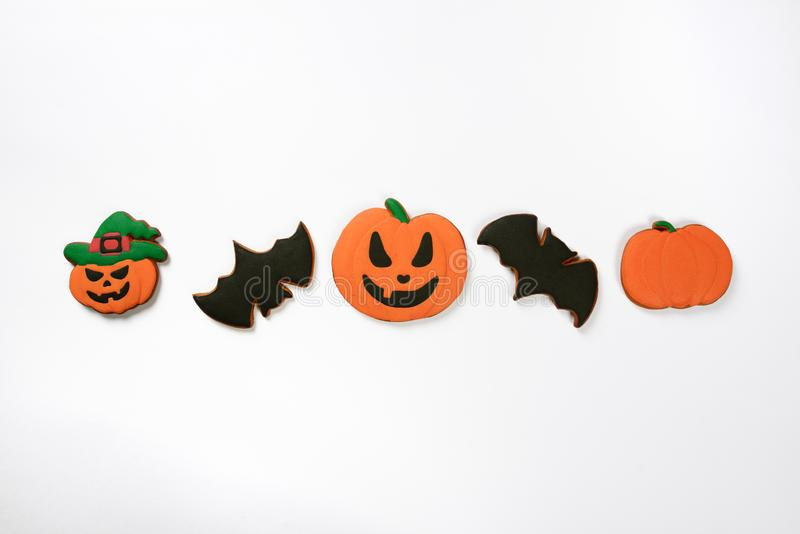The hand-made eatable gingerbread Halloween pumpkins and bats stock photo