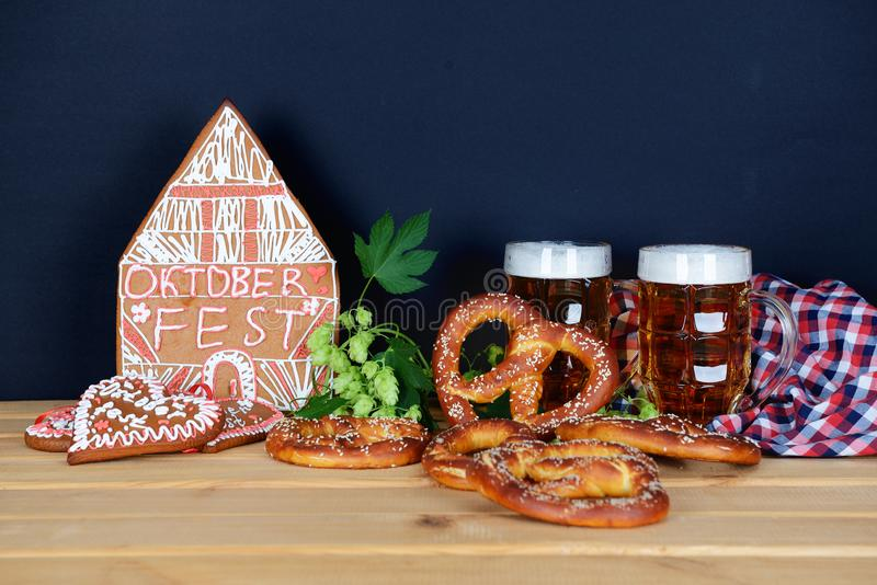 The hand-made eatable gingerbread house, beer, hops, pretzels for Octoberfest. Party stock photos