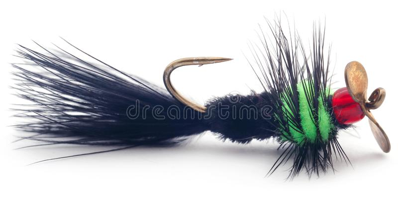 Fishing fly with hook hand made. Hand made fishing fly with hook over white background royalty free stock photo