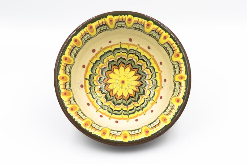 Hand made and hand painted soup bowl viewed from the top with  green,orange and yellow bright colors. stock photos