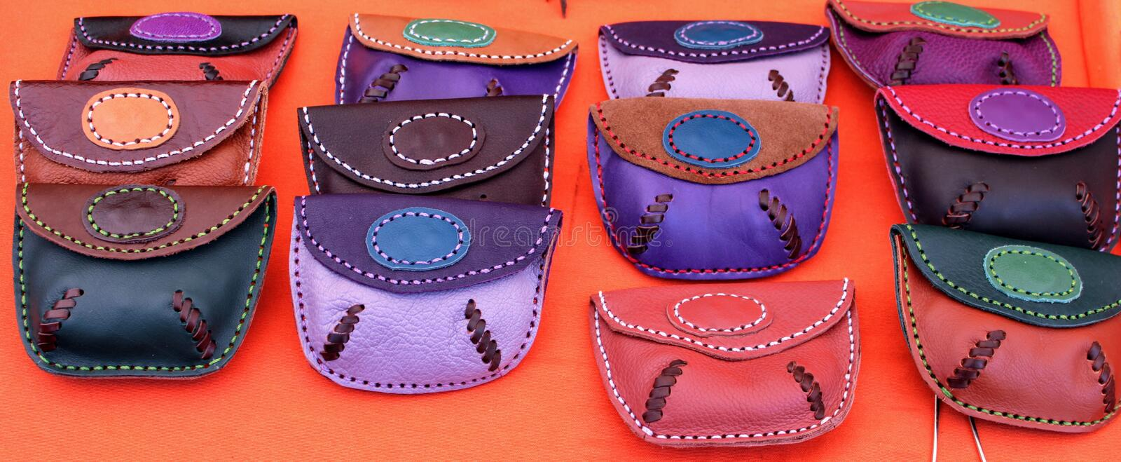 Hand made leather purses stock photos