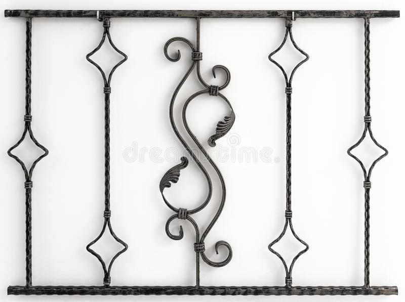 Hand made metal wall decoration element on white wall background backdrop.  royalty free stock images