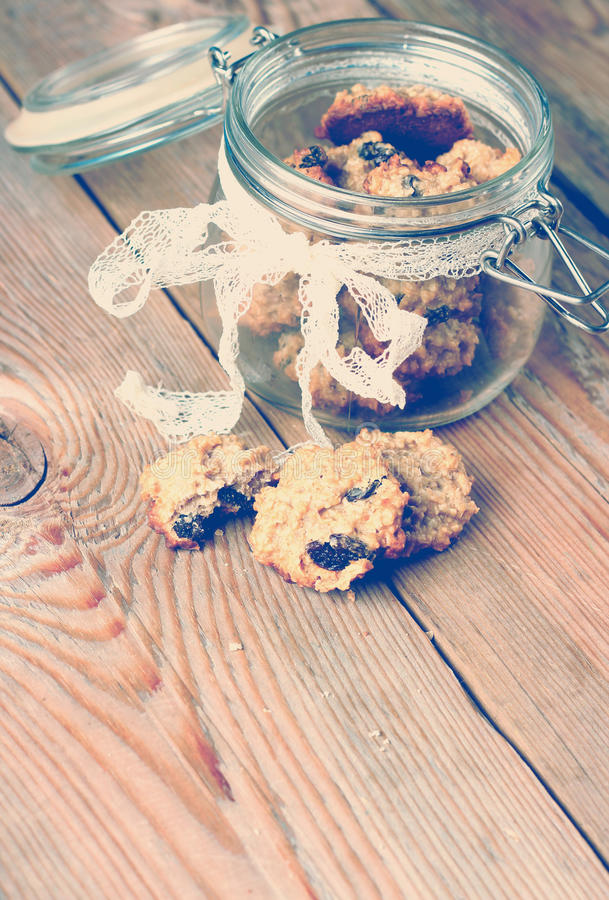 Hand made oatmeal cookies in a jar in a vintage style. Selective focus, copy space background royalty free stock image