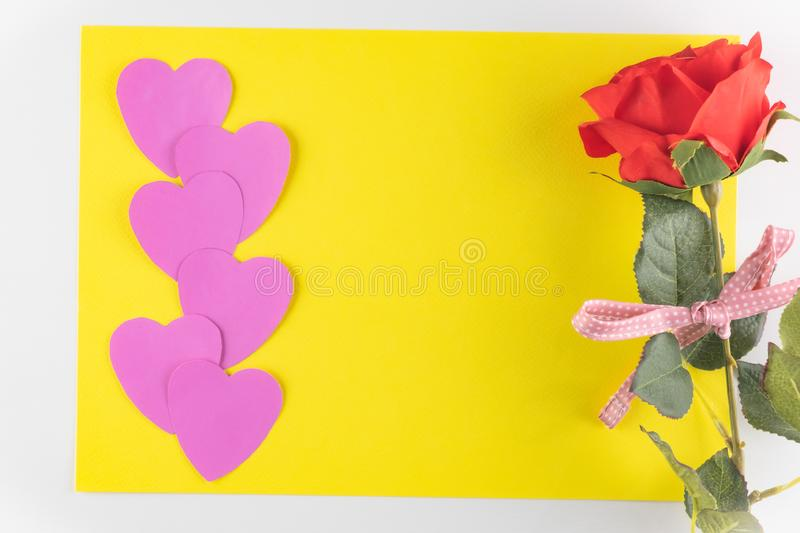 Hand-made pink love hearts isolated on yellow texture background, Happy valentine`s day. holiday background, Flat lay. Top view, copy space stock images
