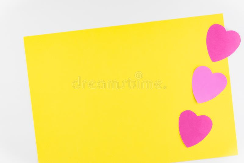 Hand-made pink love hearts isolated on yellow texture background, Happy valentine`s day. holiday background, Flat lay. Top view, copy space stock image