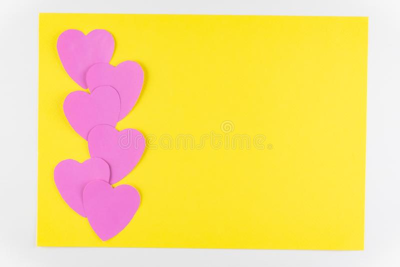 Hand-made pink love hearts isolated on yellow texture background, Happy valentine`s day. holiday background, Flat lay. Top view, copy space royalty free stock images