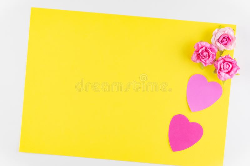 Hand-made pink love hearts isolated on yellow texture background, Happy valentine`s day. holiday background, Flat lay. Top view, copy space royalty free stock photos