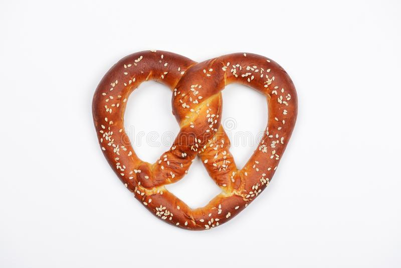 The hand-made pretzel for Octoberfest party. On white background royalty free stock image