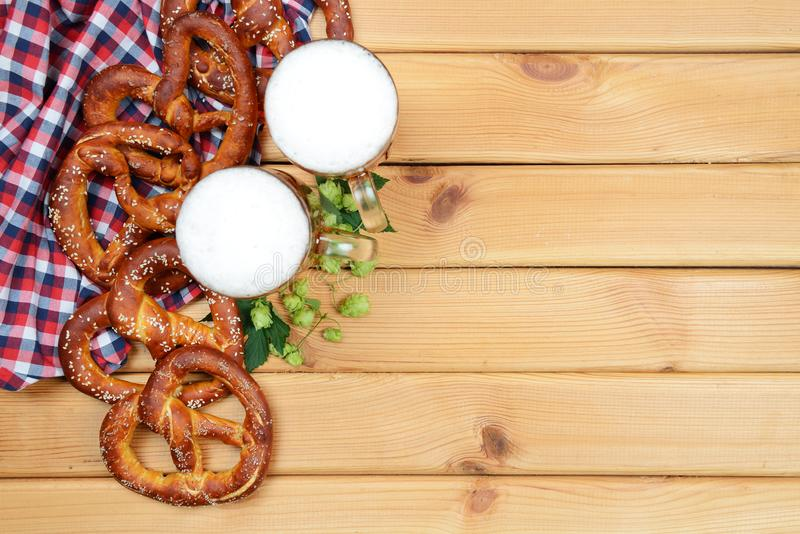 The hand-made pretzels, beer and hops for Octoberfest. Party royalty free stock photo
