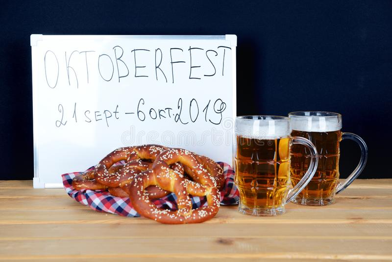 The hand-made pretzels and beer for Octoberfest. Party royalty free stock photos