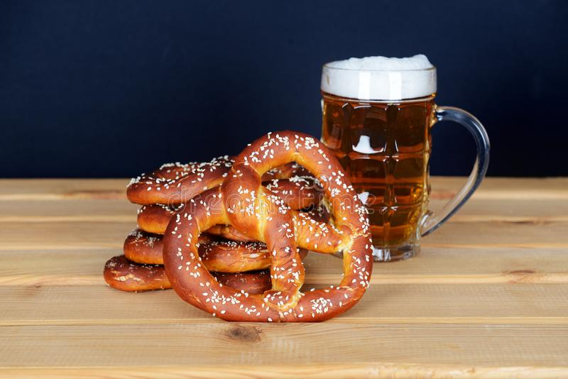 The hand-made pretzels and beer for Octoberfest. Party royalty free stock photo