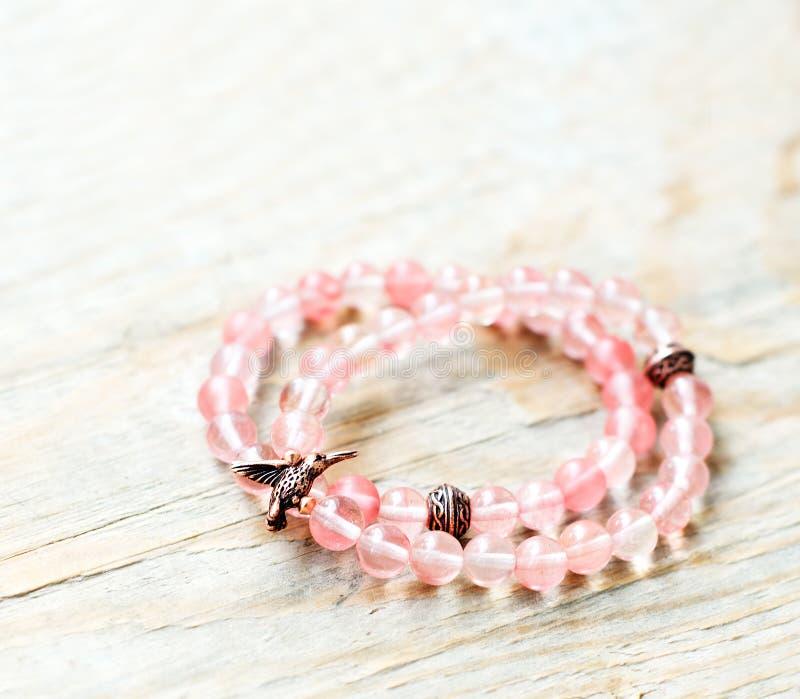 Hand-made quartz bracelets stock photos