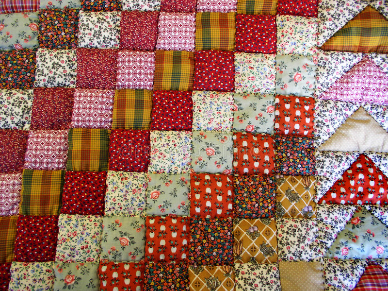 Hand-made quilt stock photo