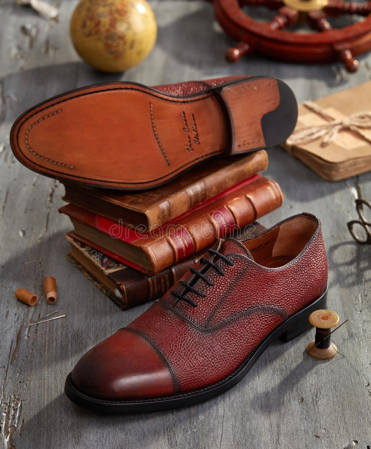 Hand made shoes. On wood royalty free stock photo