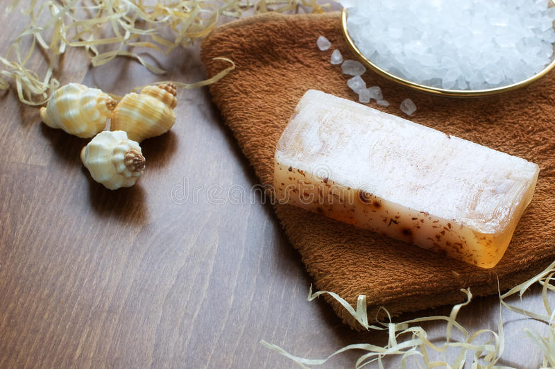 Hand-made soap, bath salt, shells, towel royalty free stock photo