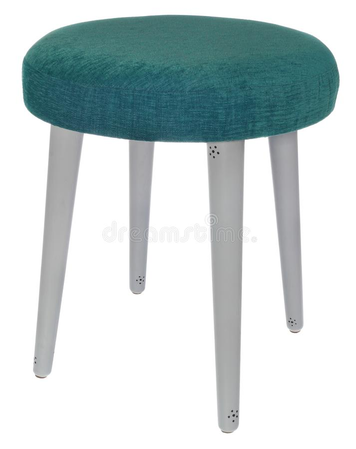 Handmade stool in gray colour with black dots with green sea col. Hand made stool. Hand painted wooden legs of chair in gray colour with black dots. Round seat royalty free stock images