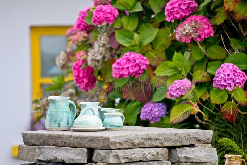 Hand made tea set on a stone wall stock photos