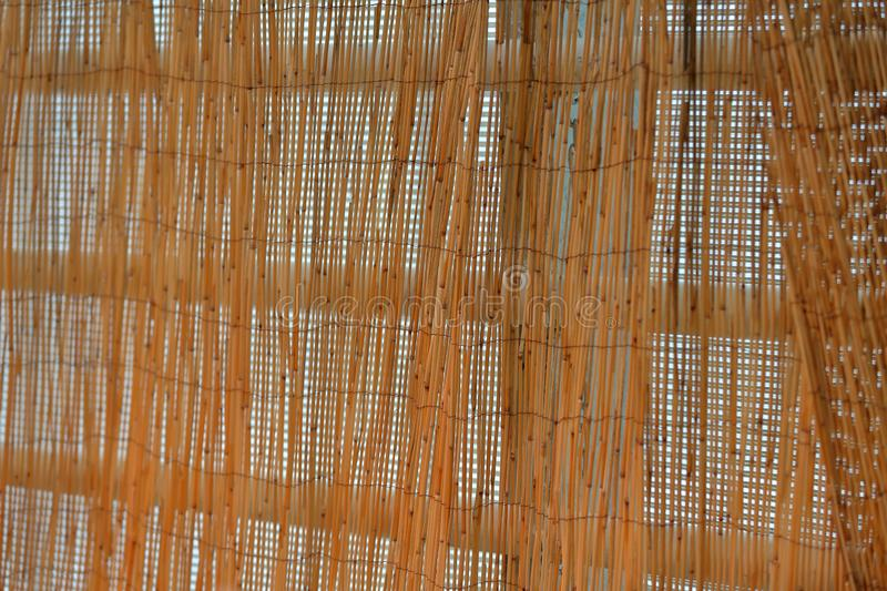 Hand made thin bamboo blinds. Craft blinds made of thin brown bamboo in the doorway royalty free stock image