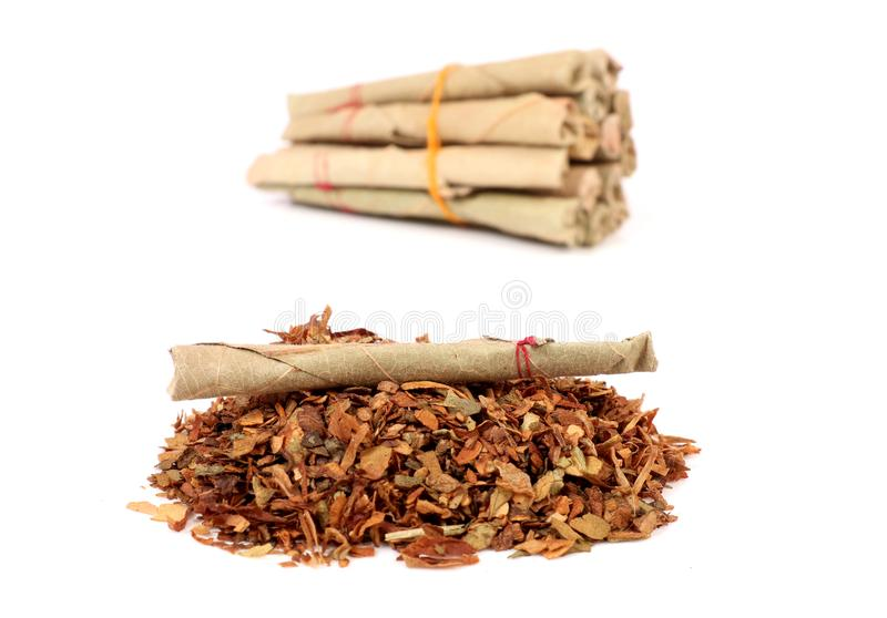 Hand-made tobacco cigarettes. Beautiful shot of hand-made tobacco cigarettes royalty free stock image