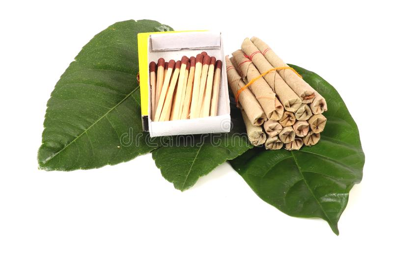 Hand-made tobacco cigarettes with matchsticks. Beautiful shot of hand-made tobacco cigarettes with matchsticks royalty free stock image