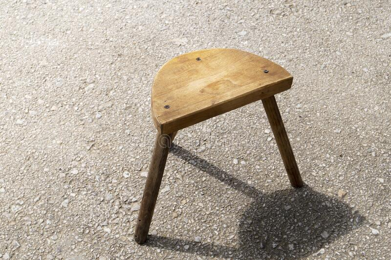 Hand made wooden stool standing outside stock image