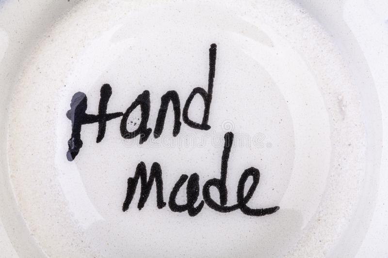 Hand made written sign on dish. Hand made sign on the bottom of a dish royalty free stock photo