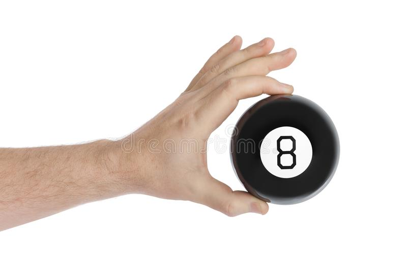 Hand with magic billiard ball number eight stock images