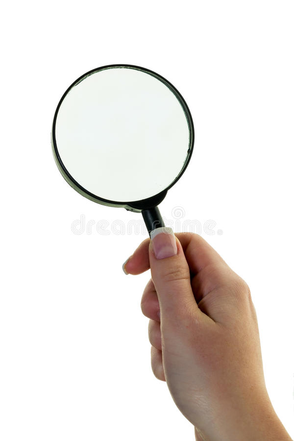 Hand with a magnifying glass royalty free stock photos