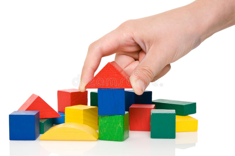 Download Hand Make A Building Of Colored Blocks. Stock Image - Image: 20122571