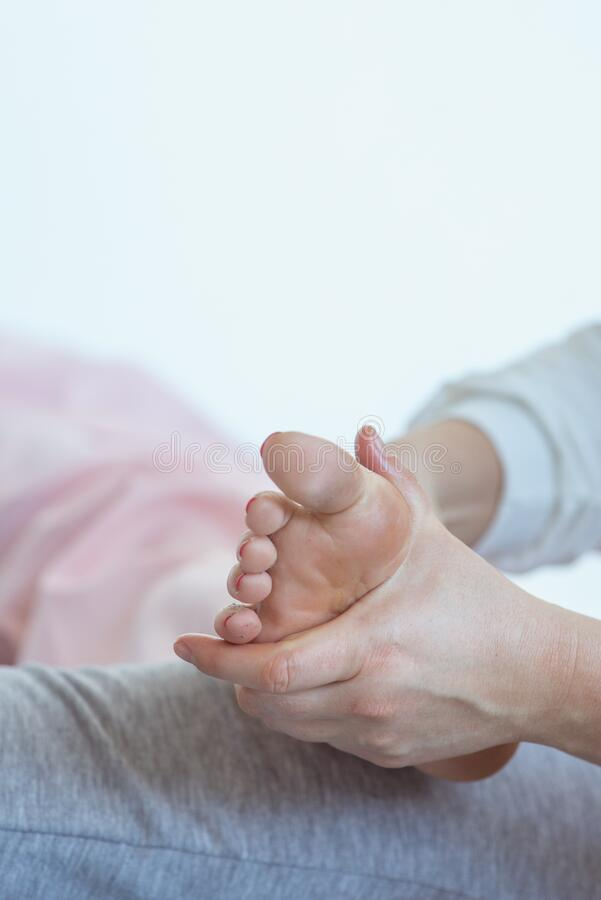 Hand making thai feet massage stock image