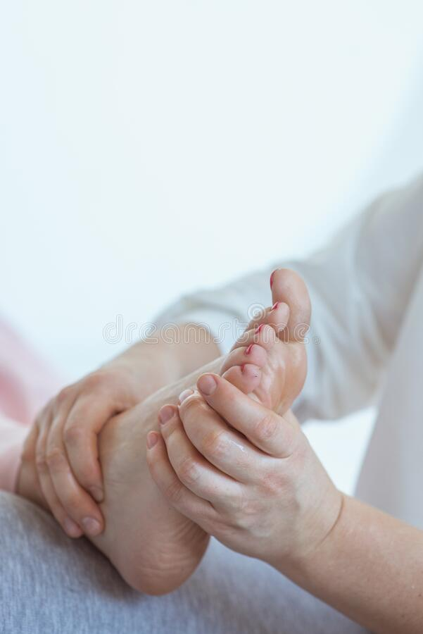 Hand making thai feet massage royalty free stock photo