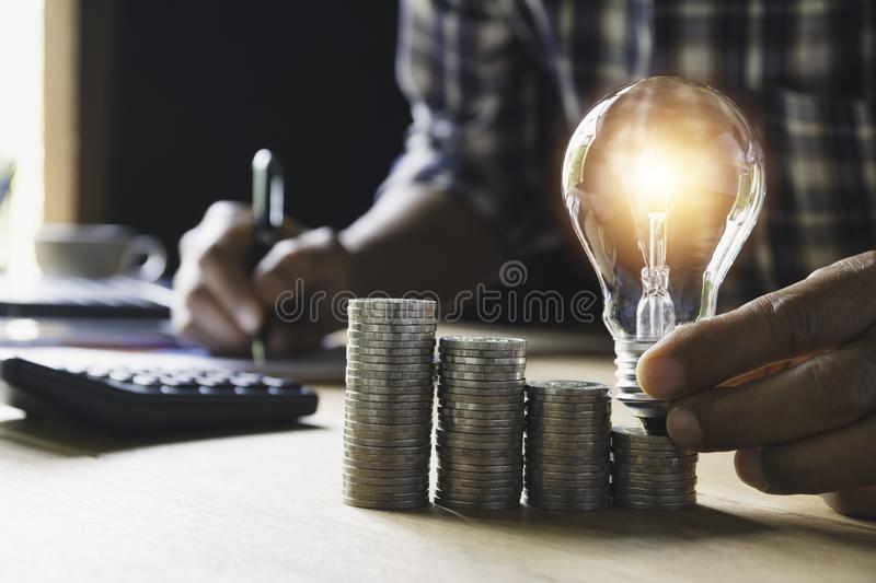 Hand of male holding a light bulb and copy space for accounting, ideas and creative concept royalty free stock image