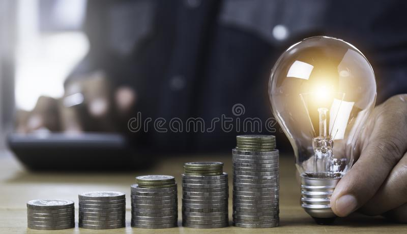 Hand of male holding a light bulb and copy space for accounting, ideas and creative concept stock photo