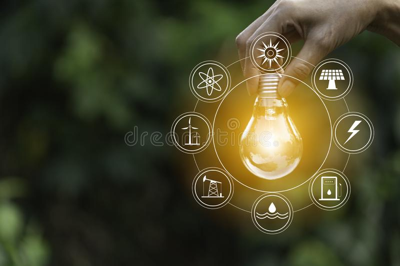 Hand of male holding a light bulb and copy space. Ideas and creative concept royalty free stock photo