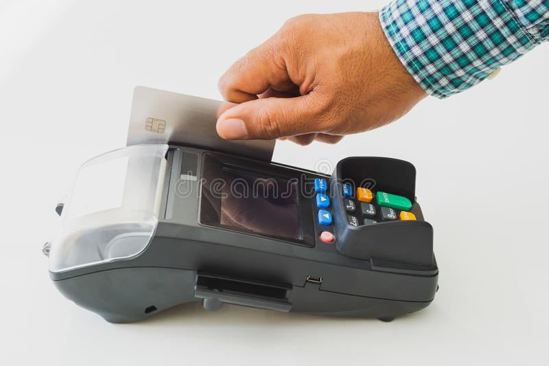 Hand man with credit card machine. Atm, background, bank, banking, business, buy, cash, chip, close, customer, debit, device, digital, electronic, finance stock image