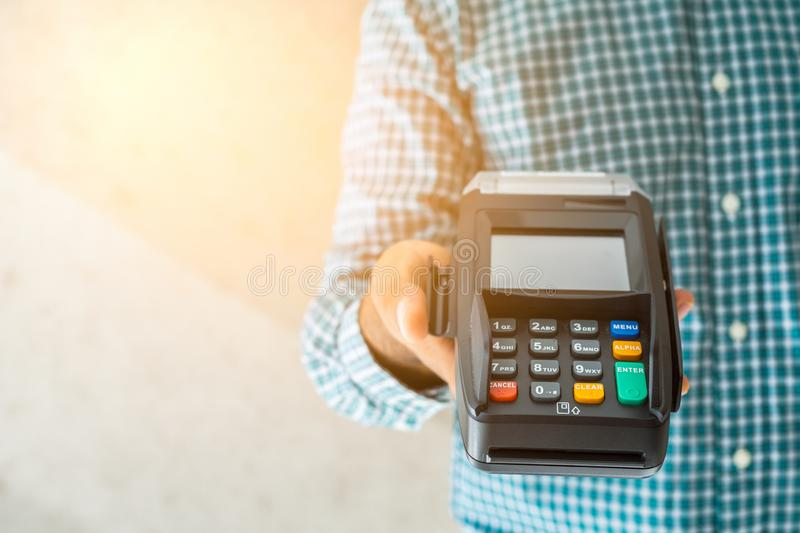 Hand man with credit card machine. Atm, background, bank, banking, business, buy, cash, chip, close, customer, debit, device, digital, electronic, finance royalty free stock photography