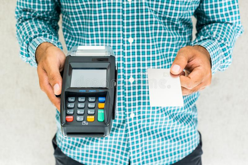 Hand man with credit card machine. Atm, background, bank, banking, business, buy, cash, chip, close, customer, debit, device, digital, electronic, finance royalty free stock photos