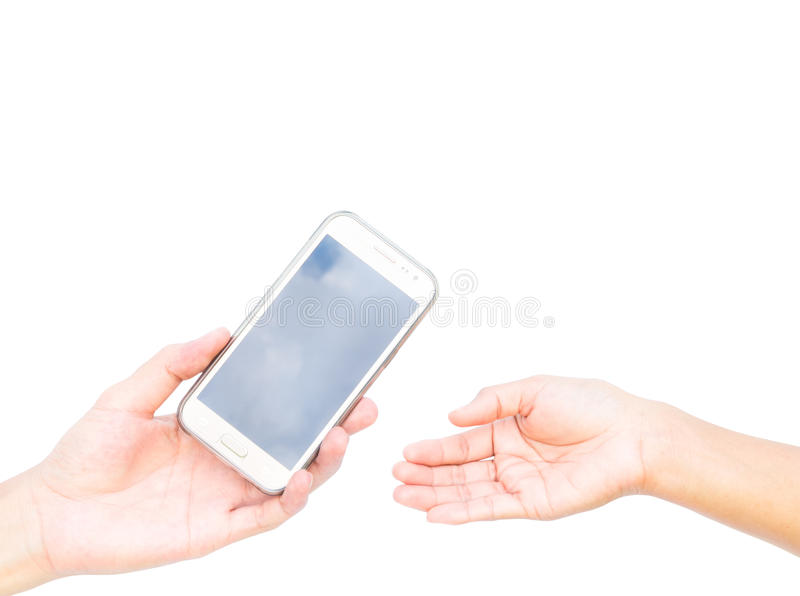 Hand of man delivering mobile phone to woman's hand on white bac stock photos